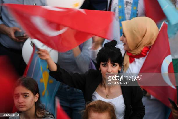 Supporters await the arrival of leader of Turkey's Iyi Party and presidential candidate Meral Aksener to speak at Fath Vatan Caddesi during a rally...
