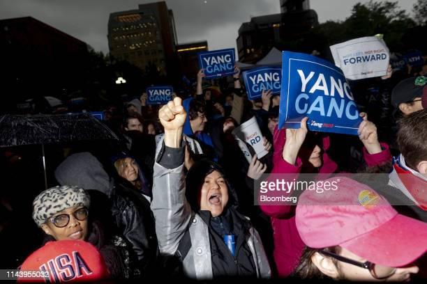 Supporters cheer and hold up placards as they listen to Andrew Yang founder of Venture for America and 2020 Democratic presidential candidate not...