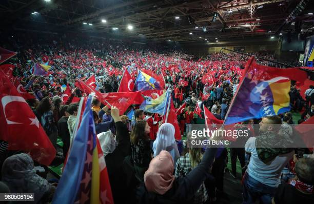Supporters cheer and listen as Turkish President speaks during a preelection rally in Sarajevo on May 20 2018 Recep Tayyip Erdogan holds today the...
