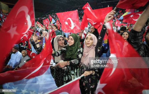TOPSHOT Supporters cheer and listen as Turkish President speaks during a preelection rally in Sarajevo on May 20 2018 Recep Tayyip Erdogan holds...