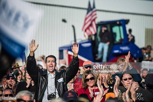 Supporters cheer and listen while Republican nominee for President Governor Mitt Romney speak at a rally in Davenport Iowa Monday October 2012
