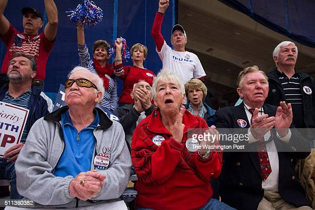 Supporters cheer and wait before republican presidential candidate Donald Trump arrives to speak at a campaign event held at the Myrtle Beach Sports...