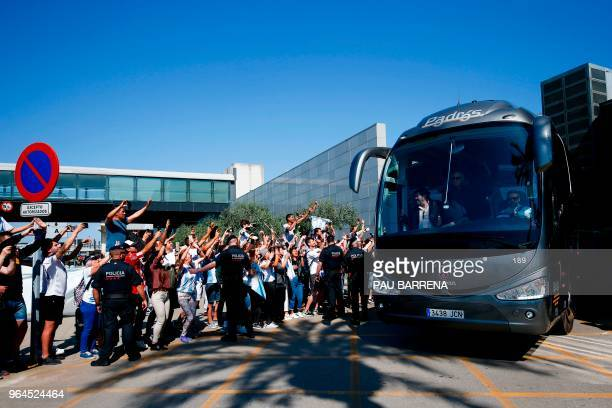 Supporters cheer as Argentina's national football team leaves El Prat airport upon its arrival in Barcelona on May 31 2018