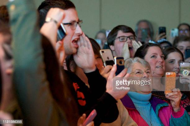 Supporters cheer as Beto ORourke takes the stage during a campaign stop in State College PA on March 19 2019 The candidate from El Paso TX is the...