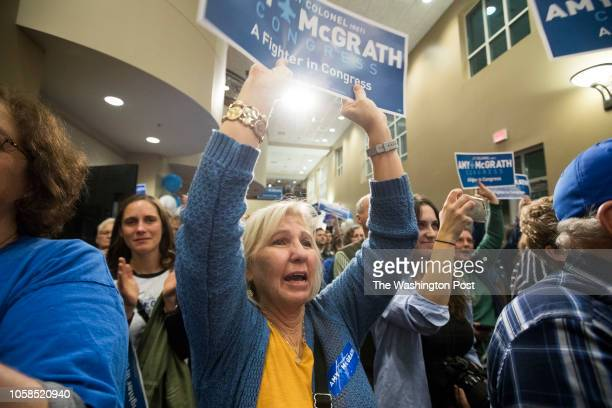 RICHMOND KENTUCKY USA NOVEMBER 6 2018 Supporters cheer as Democratic nominee Amy McGrath concedes the election for Kentuckys 6th congressional...