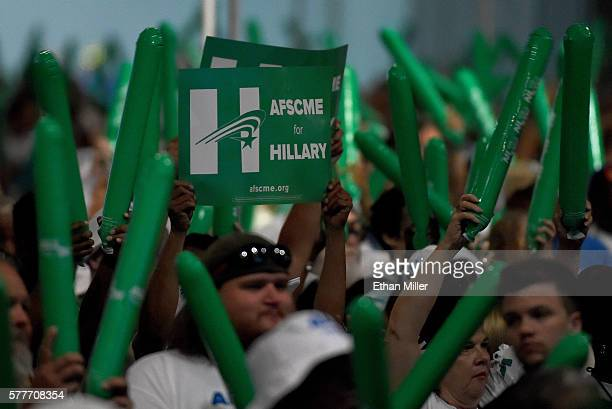 Supporters cheer as Democratic presidential candidate Hillary Clinton speaks at the American Federation of State County and Municipal Employees 42nd...