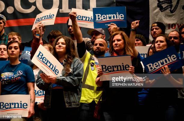 Supporters cheer as Democratic presidential candidate Senator Bernie Sanders speaks at a campaign stop in Ames, Iowa on January 25, 2020. - Sanders...