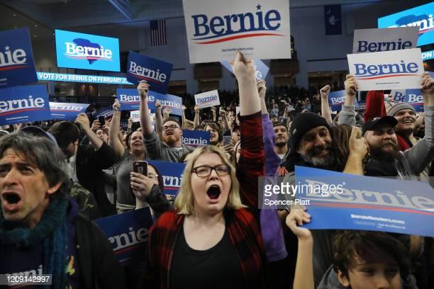 Supporters cheer as Democratic presidential frontrunner Senator Bernie Sanders speaks to on February 27 2020 in Spartanburg South Carolina Sanders a...