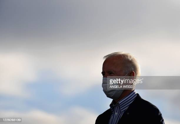Supporters cheer as Democratic presidential nominee and former Vice President Joe Biden's arrives to speak at a Drive-In event with Bon Jovi at...