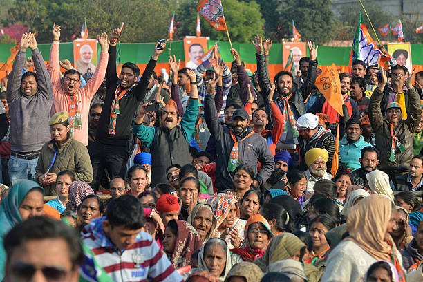 Supporters cheer as Indian Prime Minister Narendra Modi speaks during the Bharatiya Janata Party rally at the PAP ground in Jalandhar on January 27...