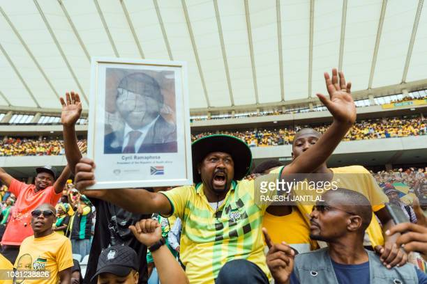 Supporters cheer as President Cyril Ramaphosa arrives at the African National Congress 107th anniversary celebrations at the Moses Mabhida Stadium in...
