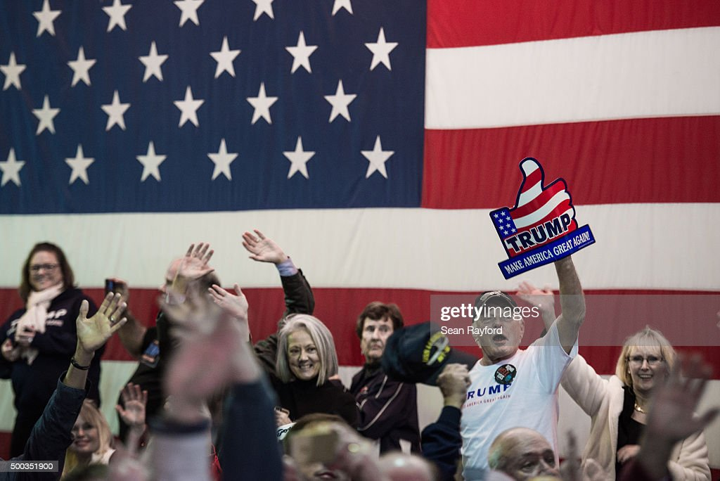 Supporters cheer as Republican presidential candidate Donald Trump speaks to the crowd Pearl Harbor Day Rally At USS Yorktown Monday, December 7, 2015, in Mt. Pleasant, South Carolina. The South Carolina Republican primary is scheduled for February 20, 2016.