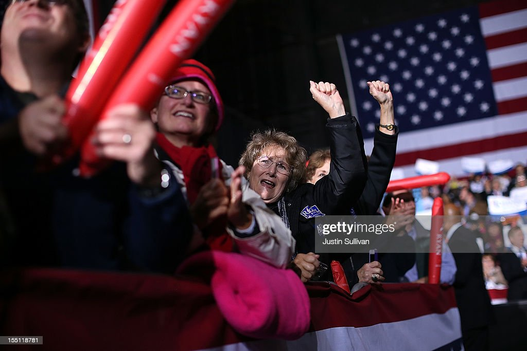 Supporters cheer as Republican presidential candidate, former Massachusetts Gov. Mitt Romney speaks during a campaign event at Farm Bureau Live on November 1, 2012 in Virginia Beach, Virginia. With less than one week to go until election day, Mitt Romney is campaigning in Virginia.