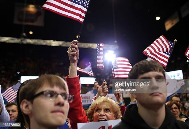 Supporters cheer as Republican presidential candidate former Massachusetts Gov Mitt Romney speaks during a campaign rally at George Mason University...