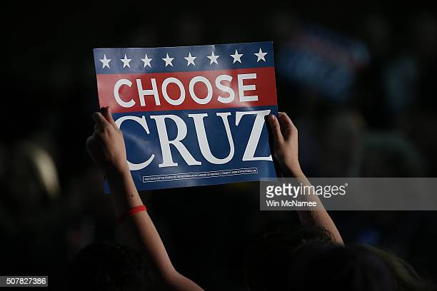 Supporters cheer as Republican presidential candidate Sen Ted Cruz speaks to Iowa voters at the Iowa State Fairgrounds January 31 2016 in Des Moines...