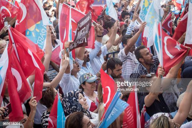 Supporters cheer as the listen to a speech by leader of Turkey's Iyi Party and presidential candidate Meral Aksener during a rally on June 1 2018 in...