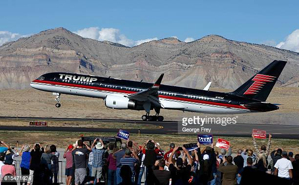 Supporters cheer as the plane of Republican presidential candidate Donald Trump lands on October 18 2016 in Grand Junction Colorado Trump who spoke...
