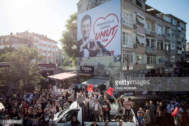 Supporters cheer as they listen to Ekrem Imamoglu CHP Party candidate for mayor of Istanbul speak at a rally during campaigning in the rerun of the...