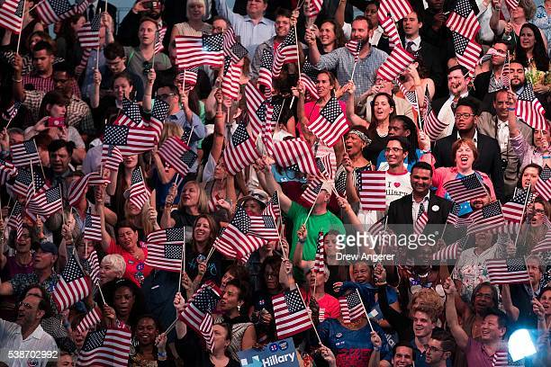 Supporters cheer as they wait for the start of a primary night rally for Democratic presidential candidate Hillary Clinton at the Duggal Greenhouse...
