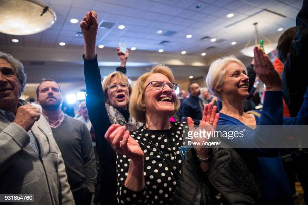 Supporters cheer as they watch election returns at an election night event for Conor Lamb Democratic congressional candidate for Pennsylvania's 18th...