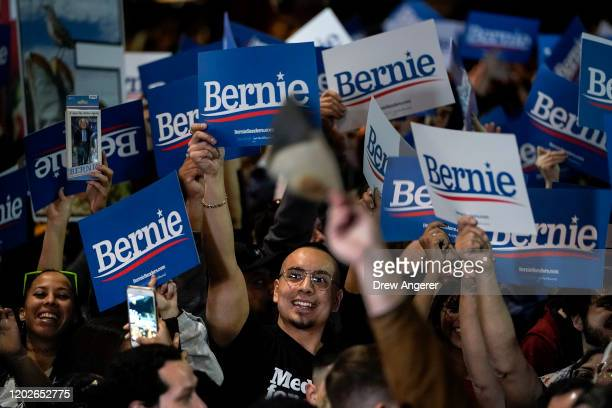 Supporters cheer as they watch returns from the Nevada caucuses while waiting for Democratic presidential candidate Sen Bernie Sanders to arrive for...