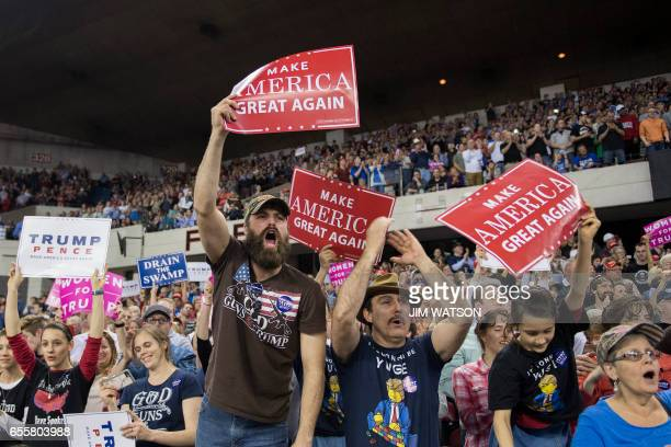 Supporters cheer as US President Donald Trump addresses a 'Make America Great Again' rally at the Kentucky Exposition Center in Louisville Kentucky...