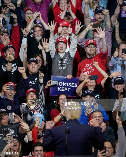 Supporters cheer as US President Donald Trump arrives for a Keep America Great rally at Southern New Hampshire University Arena on February 10 2020...