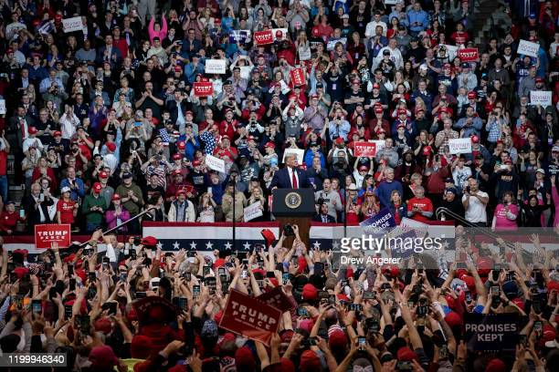 "Supporters cheer as U.S. President Donald Trump arrives for a ""Keep America Great"" rally at Southern New Hampshire University Arena on February 10,..."