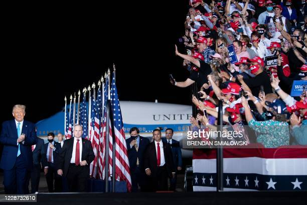 TOPSHOT Supporters cheer as US President Donald Trump arrives to a Make America Great Again campaign rally at Harrisburg international airport in...