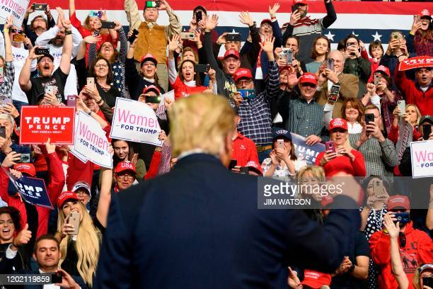 """Supporters cheer as US President Donald Trump arrives to address a """"Keep America Great"""" rally in Colorado Springs, Colorado, on February 20, 2020."""