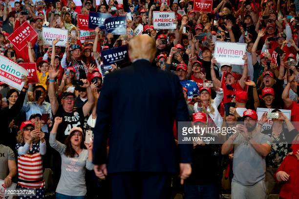 Supporters cheer as US President Donald Trump arrives to deliver remarks at a Keep America Great rally in Las Vegas, Nevada, on February 21, 2020.