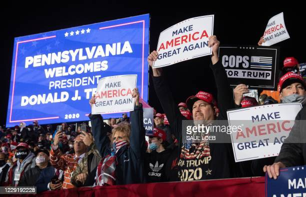 Supporters cheer as US President Donald Trump holds a Make America Great Again rally at Erie International Airport in Erie, Pennsylvania, October 20,...