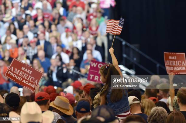 Supporters cheer as US President Donald Trump speaks at a 'Make America Great Again' rally in Phoenix Arizona on August 22 2017 / AFP PHOTO /...