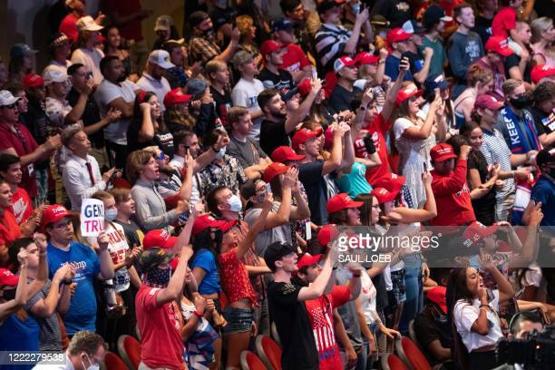 Supporters cheer as US President Donald Trump speaks during a Students for Trump event at the Dream City Church in Phoenix, Arizona, June 23, 2020.