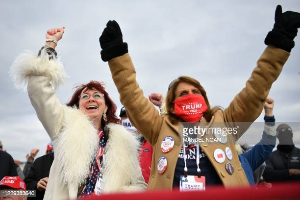 "Supporters cheer as US President Donald Trump speaks during a ""Make America Great Again"" rally at Reading Regional Airport in Reading, Pennsylvania,..."