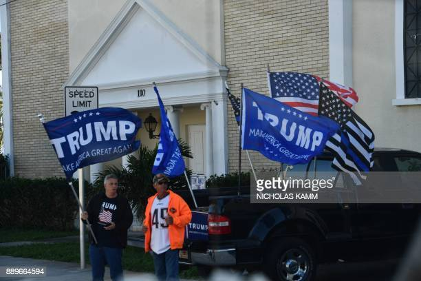 Supporters cheer as US President Donald Trump travels through West Palm Beach Florida on December 10 2017 President Trump is scheduled to return to...