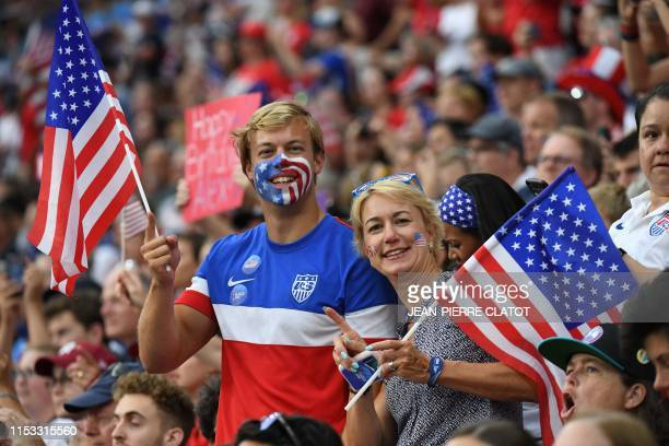 USA supporters cheer before the France 2019 Women's World Cup semifinal football match between England and USA on July 2 at the Lyon Satdium in...