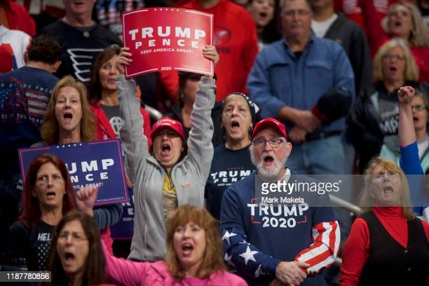 Supporters cheer before US President Donald J Trump arrives at a campaign rally on December 10 2019 in Hershey Pennsylvania This rally marks the...