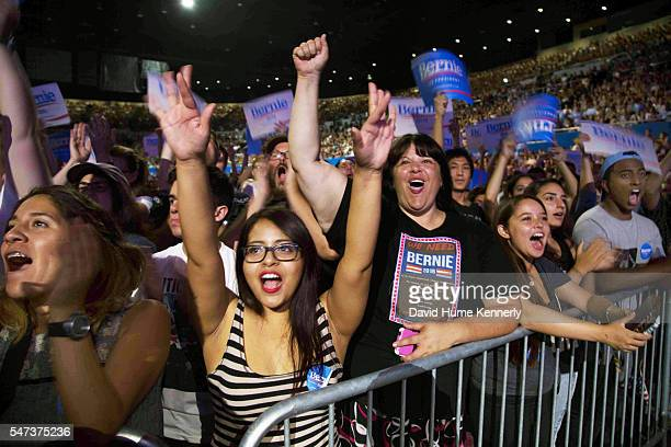 Supporters cheer democratic presidential candidate Sen Bernie Sanders at a rally at the Los Angeles Memorial Sports Arena August 10 2015 His campaign...