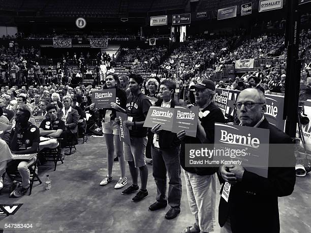 Supporters cheer democratic presidential candidate Sen. Bernie Sanders of Vermont at the New Hampshire Democratic Party Convention in Manchester, New...