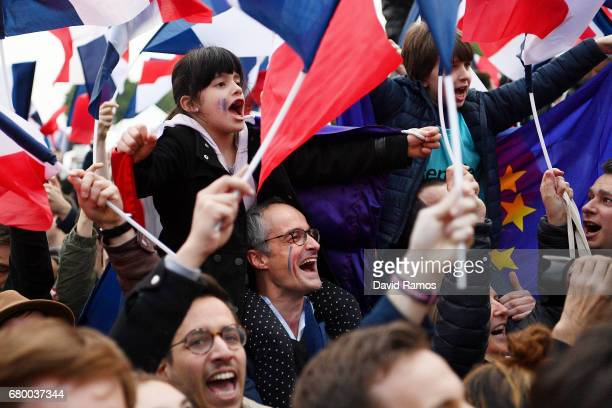 Supporters cheer during Emmanuel Macron's Electoral Evening at The Louvre on May 7 2017 in Paris France Voters are going to the polls to choose their...