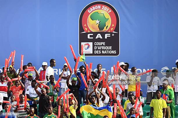 Supporters cheer during the 2017 Africa Cup of Nations group A football match between Gabon and GuineaBissau at the Stade de l'Amitie SinoGabonaise...