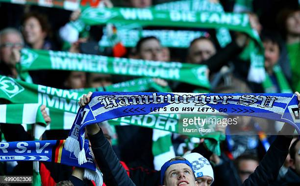 Supporters cheer during the Bundesliga match between SV Werder Bremen and Hamburger SV at Weserstadion on November 28 2015 in Bremen Germany