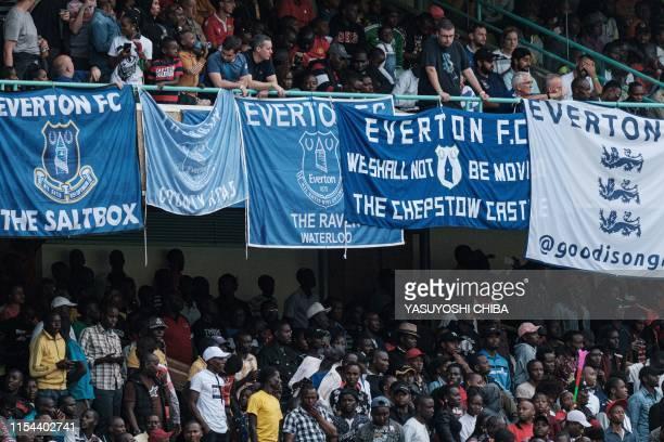 Supporters cheer during the friendly football match between Kariobangi Sharks and Everton at the Kasarani Stadium in Nairobi on July 7 2019