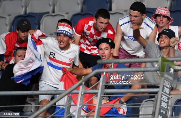 Supporters cheer for Croatia's Marin Cilic as he plays against Ryan Harrison of the US during their men's singles third round match on day five of...