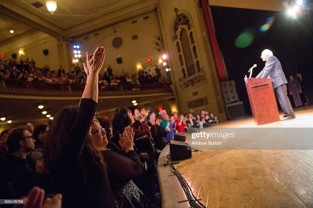 Supporters cheer for Democratic presidential candidate Sen. Bernie Sanders (I-VT) as he outlines his plan to reform the U.S. financial sector on January 5, 2016 in New York City. Sanders is demanding greater financial oversight and greater government action for banks and individuals that break financial laws.