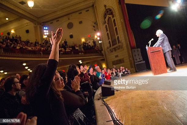 Supporters cheer for Democratic presidential candidate Sen Bernie Sanders as he outlines his plan to reform the US financial sector on January 5 2016...