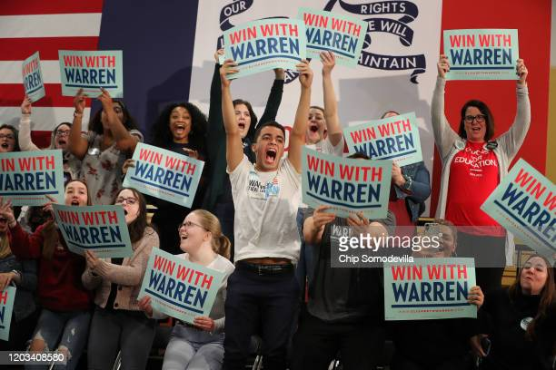 Supporters cheer for Democratic presidential candidate Sen Elizabeth Warren during a campaign rally at Kohawk Arena on the campus of Coe College...