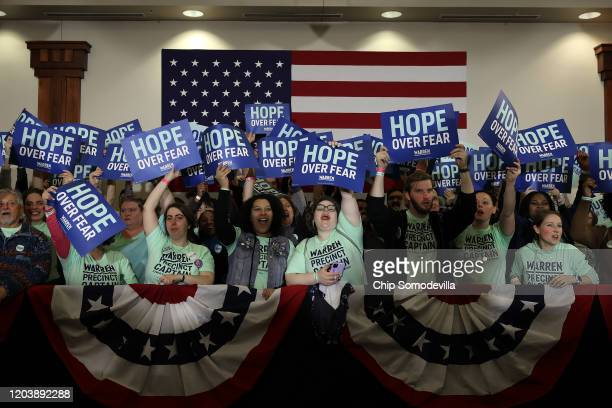 Supporters cheer for Democratic presidential candidate Sen Elizabeth Warren during a caucus night rally at the Forte Banquet and Conference Center...