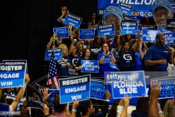 Supporters cheer for former Florida gubernatorial candidate Andrew Gillum as he addresses the audience during an event on March 20 2019 in Miami...